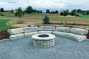 Custom Fire pit built from rock in colorado backyard