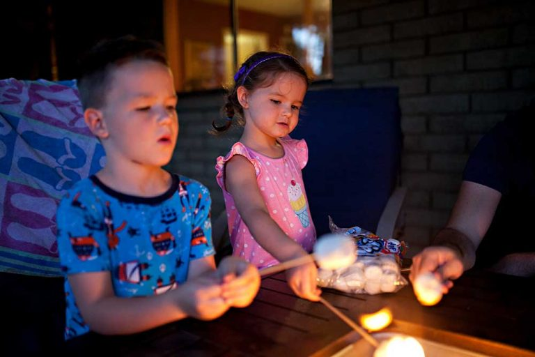 Children roasting marshmallows on installed fire pit in Northern Colorado