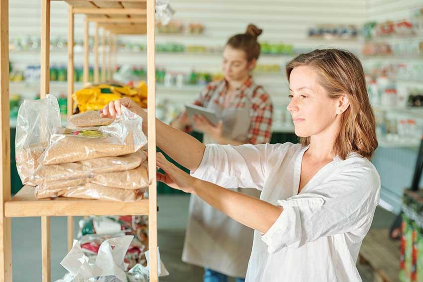 woman selecting fertilizer