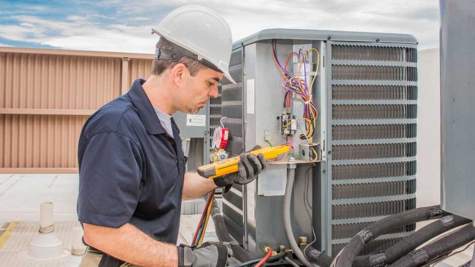 man working on hvac in fort collins