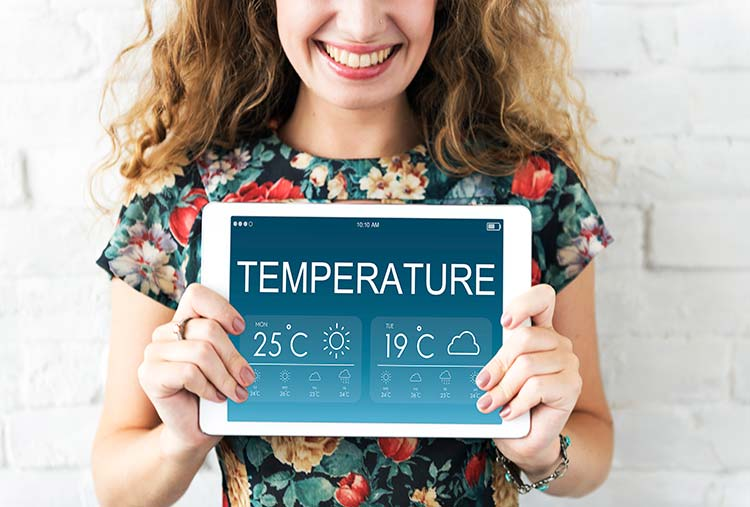 woman holding temperature sign